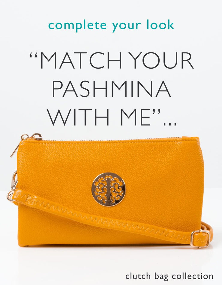 an image showing an amber yellow clutch bag