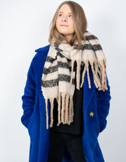 an image showing a blanket scarf in beige and red