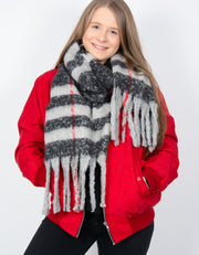 an image showing a black and red blanket scarf with long tassels