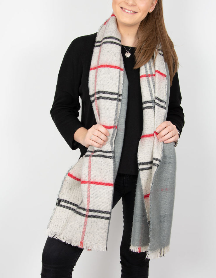 an image showing a grey and red blanket scarf