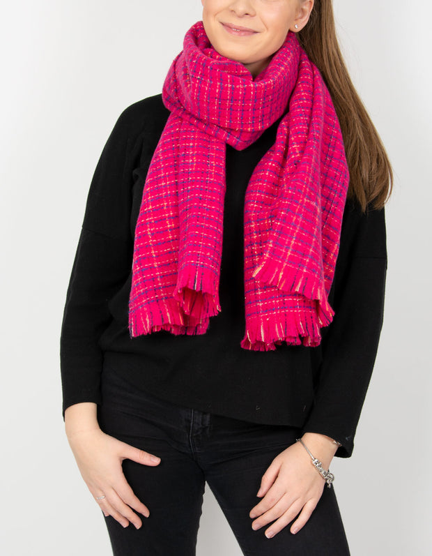 an image showing a hot pink blanket scarf