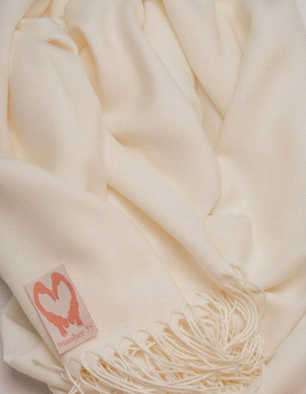 an image showing a close up view of a cream pashmina