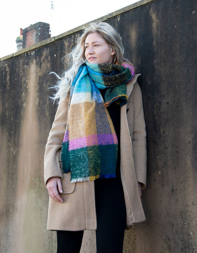 an image showing a multi-coloured blanket scarf mustard