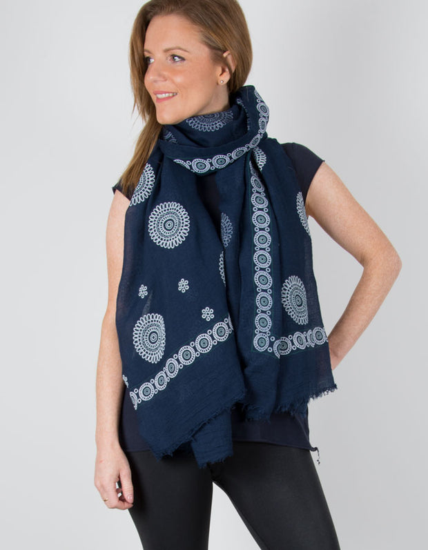 an image showing an embroidered navy scarf