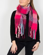 an image showing a pink and blue blanket scarf with large tassels
