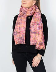 an image showing a pink blanket scarf