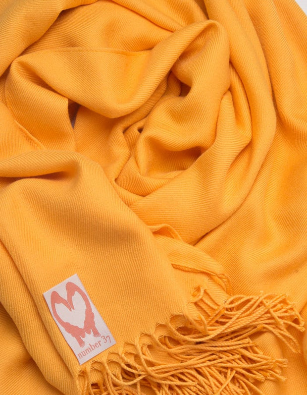 an image showing a close up of a pashmina in Amber Yellow