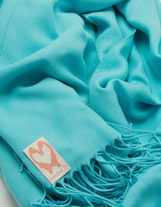 an image showing a close up of a blue pashmina in Aqua