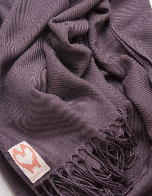 an image showing a close up of a pashmina in Aubergine purple