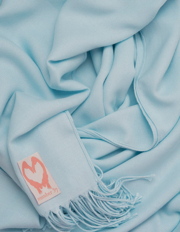 an image showing a close up of a pashmina in Baby blue