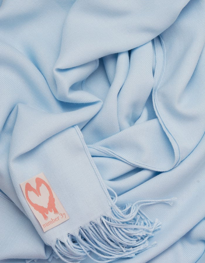 an image showing a close up of a baby blue pashmina