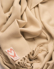an image showing a close up of a pashmina in Biscuit brown