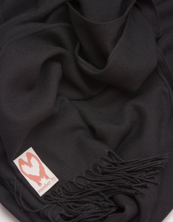 an image showing a close up of a pashmina in Black
