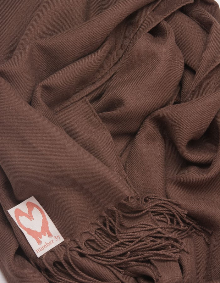 an image showing a close up of a pashmina in Brown