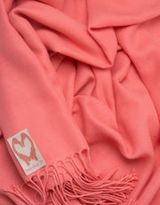 an image showing a close up of a pashmina in Coral
