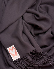 an image showing a close up of a pashmina in Dark Aubergine