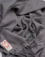 an image showing a close up of a pashmina in dark grey