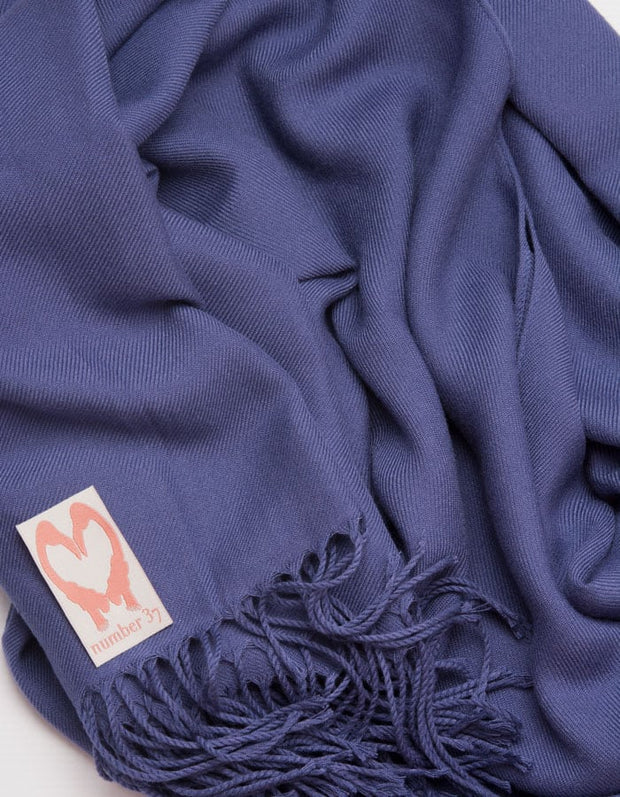an image showing a close up of a French navy blue pashmina