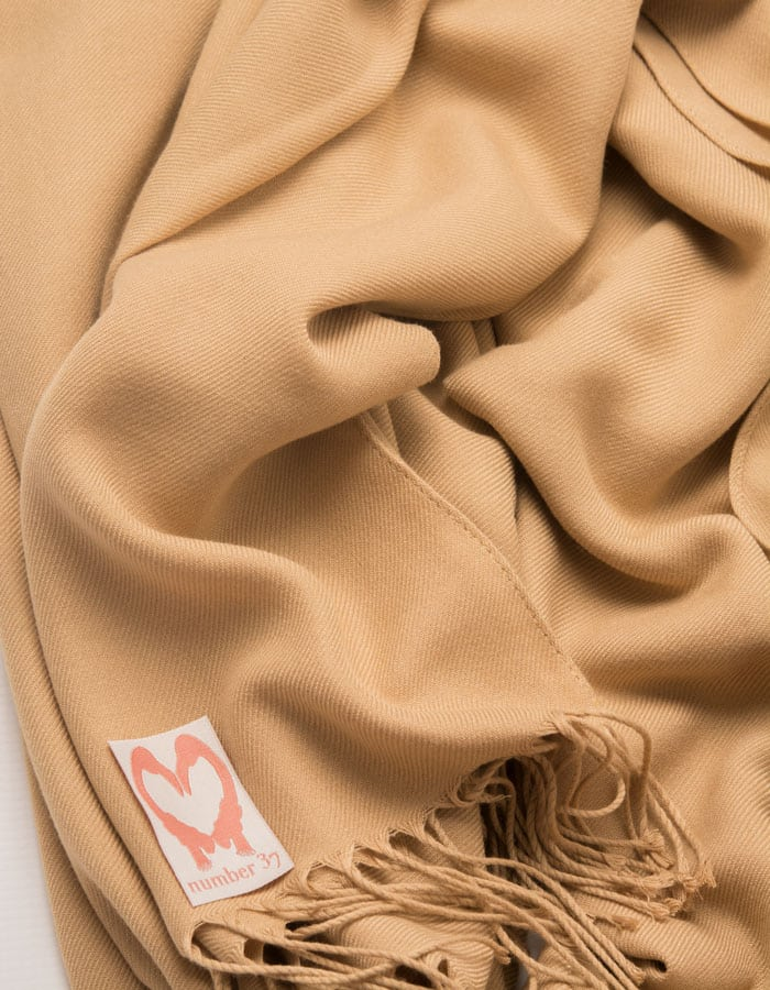 an image showing a close up of a pashmina in Gold