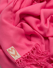 an image showing a close up of a pashmina in Hot Pink 1