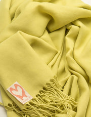 an image showing a close up of a pashmina in Lime Green
