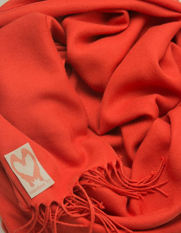 an image showing a close up of a pashmina in Mandarin Red