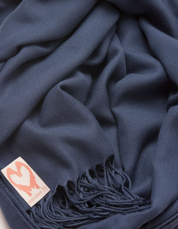 an image showing a close up of a pashmina in Moonlight Blue
