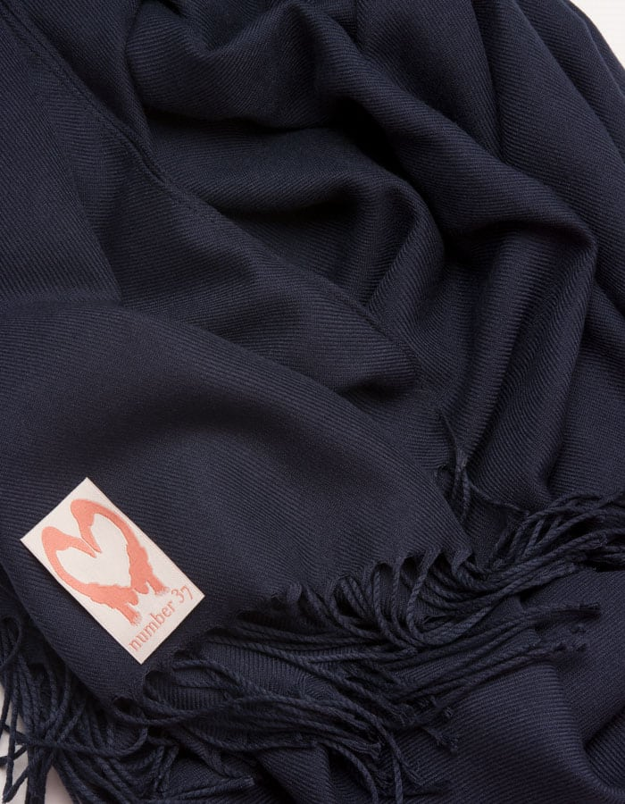 an image showing a close up of a pashmina in Navy