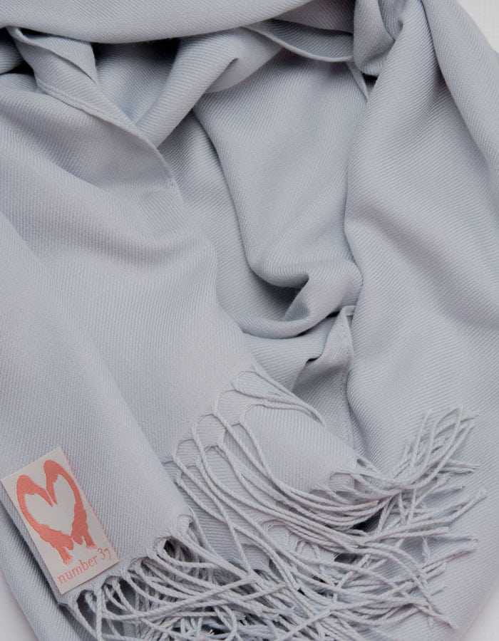 an image showing a close up of a pashmina in Pale Grey