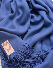 an image showing a close up of a pashmina in Royal Blue