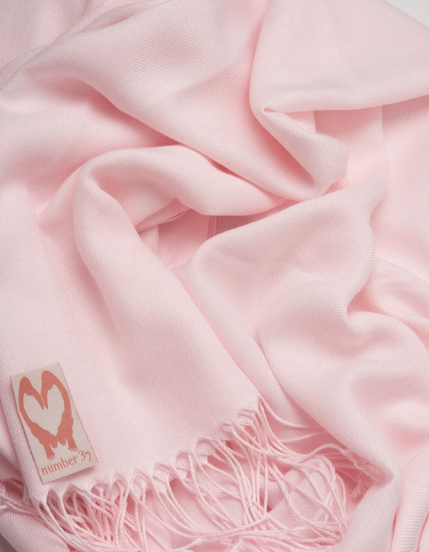 an image showing a close up of a petal pink pashmina
