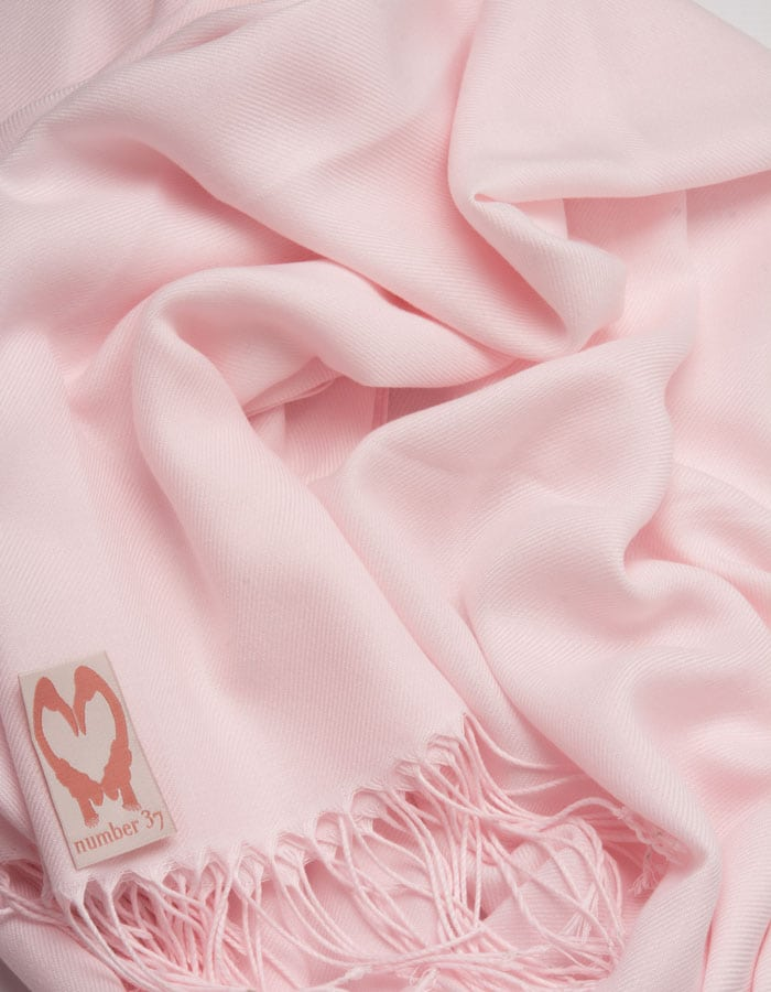 an image showing a close up of a pashmina in Petal Pink