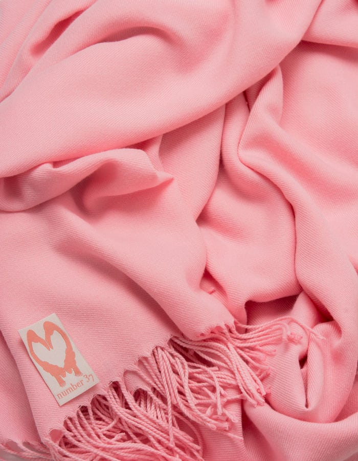 an image showing a close up of a pashmina in Pink Lady pink