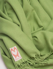 an image showing a close up of a pashmina in Pistachio Green