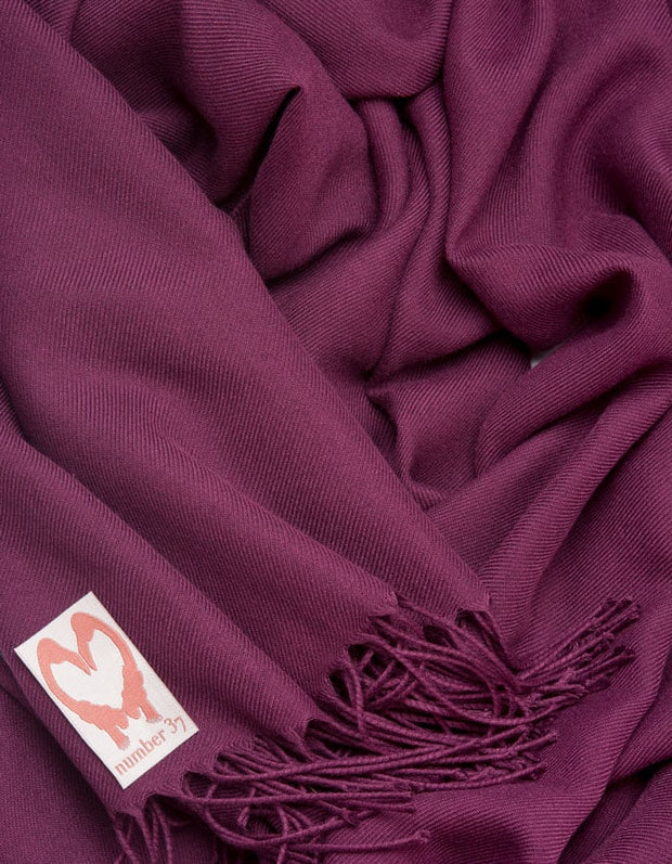 an image showing a close up of a pashmina in Plum Purple