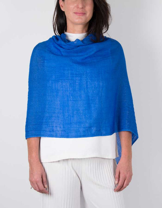 an image showing a silk wool mix wedding shawl in royal blue