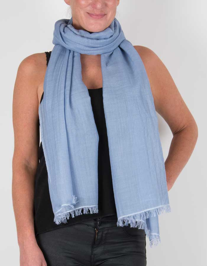 an image showing a silk wool mix pashmina in blue