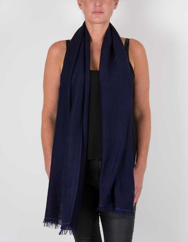 an image showing a wool silk mix pashmina in navy blue