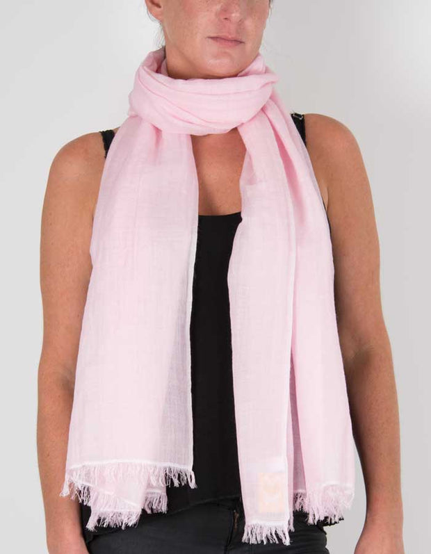 an image showing a silk wool mix pashmina in pale pink