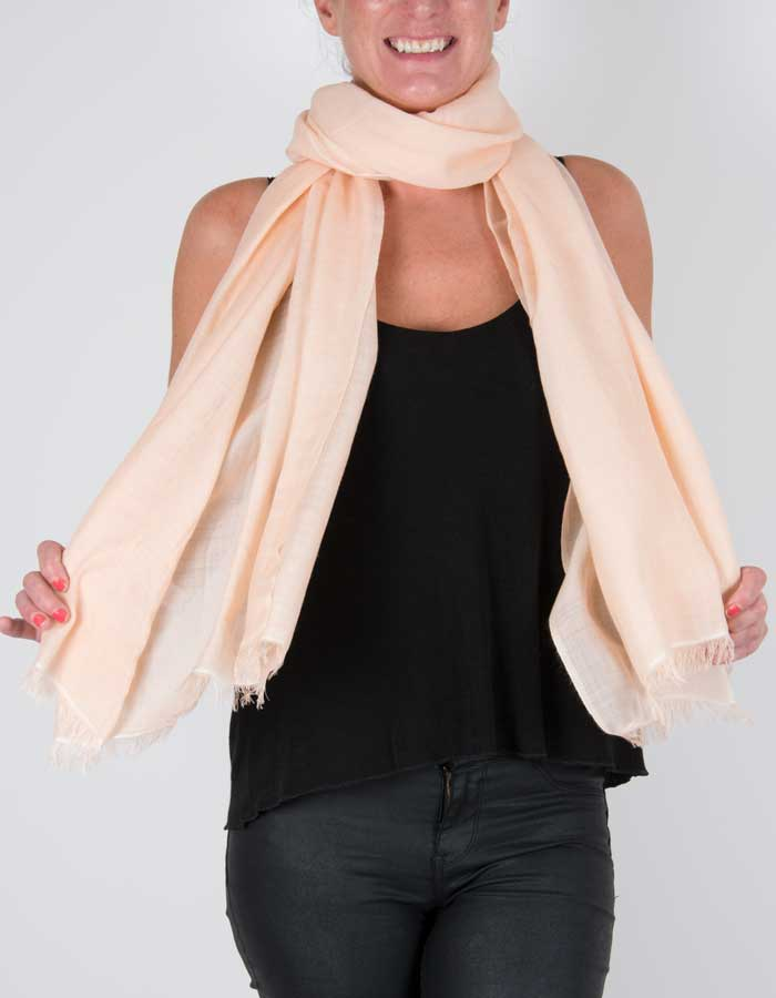 an image showing a wool silk mix pashmina in peach