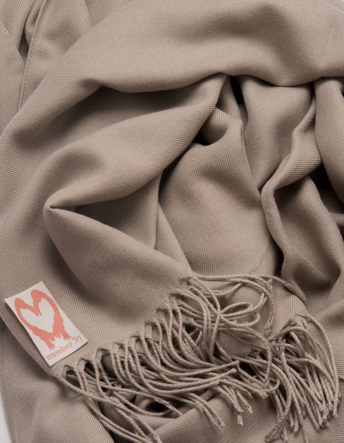 an image showing a close up of a pashmina in Taupe