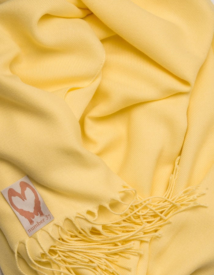 an image showing a close up of a pashmina in Yellow