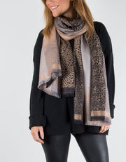 an image showing an animal print patterned pashmina in metallic gold