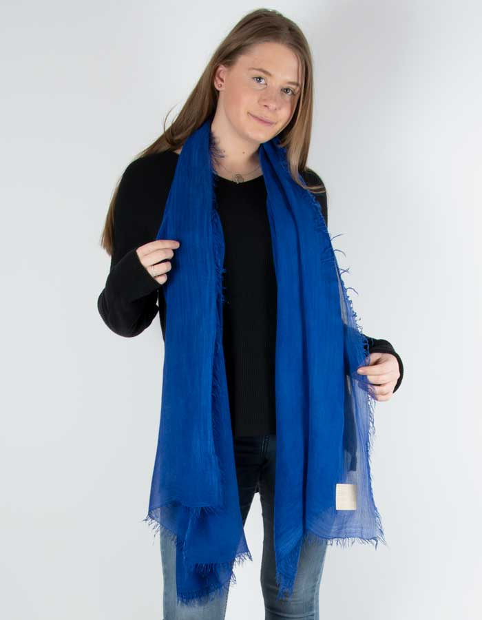 Scarf showing a blue fringed Italian MicroModal scarf