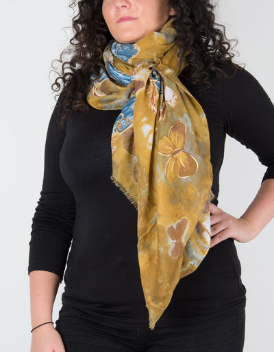 an image showing a butterfly print scarf in mustard