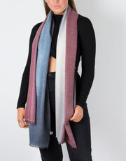 an image showing a cashmere mix scarf in navy and burgundy with glitter