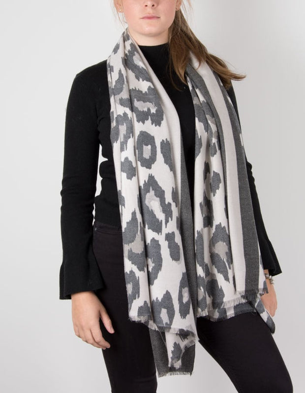 an image showing a cashmere mix animal print scarf in grey