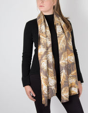 an image showing a feather print scarf in mustard