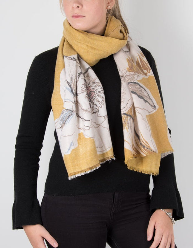 an image showing a cashmere mix floral print scarf in mustard