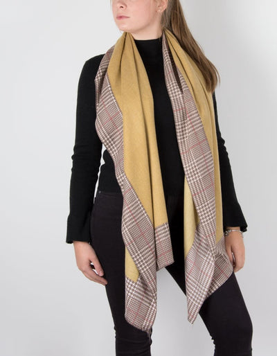 a cashmere mix scarf in mustard with a herringbone border